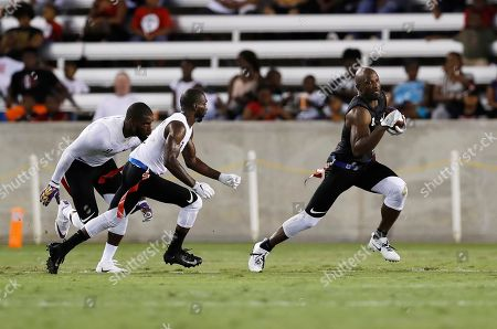 Stock Image of Jason Avant, Brandon McCray, Harry Coleman. Godspeed's Jason Avant, right, tries to evade Fighting Cancer's Brandon McCray, center, and Harry Coleman during the American Flag Football League (AFFL) U.S. Open of Football Ultimate Championship, in Houston. Fighting Cancer won 26-6