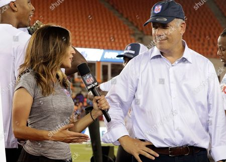 American Flag Football League (AFFL) founder Jeff Lewis, right, is interviewed for the NFL Network after the AFFL U.S. Open of Football Ultimate Championship, in Houston. Fighting Cancer won 26-6