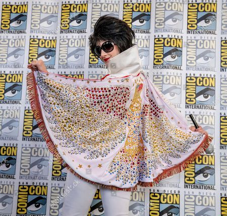 "Stock Photo of Tara Nichole Azarian. Tara Nicole Azarian of Valencia, CA strikes a pose as ""Fem Elvis"" on day one of Comic-Con International on"