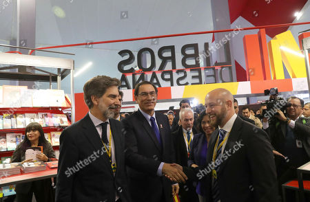 The deputy assistant director of the Book, Reading and Spanish Literature of the Ministry of Culture and Sports of Spain, David Garcia Rivas (R), greets the president of Peru, Martin Vizcarra (C), along with the ambassador of Spain in Peru, Ernesto de Zulueta (L), while walking by the stand of Spain during the opening ceremony of the Book Fair of Lima (FIL) whose guest of honor this time is Spain, in Lima, Peru, 19 July 2018.