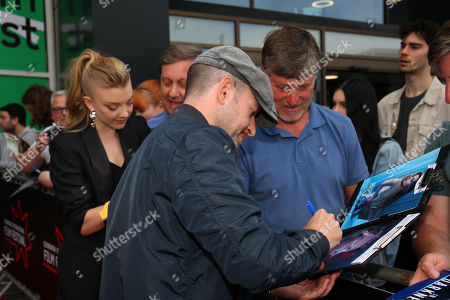 Anthony Byrne and Natalie Dormer signing autographs for fans at the premiere at Cine World Fountain Park Edinburgh.
