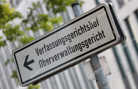 A signpost pointing to the North Rhine-Westphalian Constitutional Court and Higher Administrative Court in Muenster, Germany, 20 July 2018. The city of Bochum lodged a complaint at the Higher Administrative Court (Oberverwaltungsgericht) against the urgent decision of the Administrative Court (Verwaltungsgericht) Gelsenkirchen of 13 July 2018, according to which the deportation of the German authorities as a threat classified Tunisian Sami A. must be reversed by the immigration office. Sami A. is the ex-bodyguard of Osama Bin Laden.