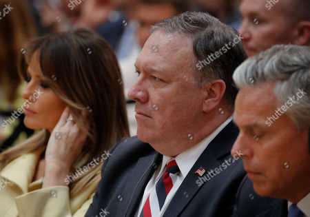 Melania Trump, Mike Pompeo, Jon Huntsman. Secretary of State Mike Pompeo, center, seated with first lady Melania Trump, left, and Jon Huntsman, right, U.S. ambassador to Russia, attend a joint news conference between U.S. President Donald Trump and Russian President Vladimir Putin at the Presidential Palace in Helsinki, Finland