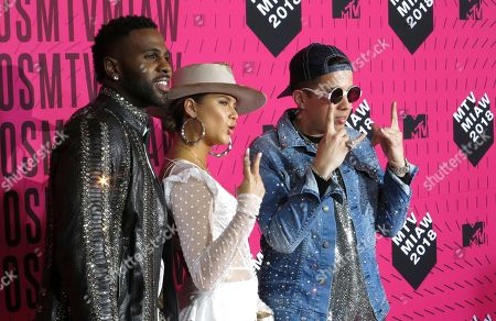 "U.S. singer Jason Derulo, left, Mexican Singer Sofia Reyes, center, and the U.S. singer De La Ghetto, arrive to the MTV MIAW awards in Mexico City. Reyes launched on July 19 an interactive version of her single ""1, 2, 3"" with Derulo and De La Ghetto to which fans can sing along at the app Smule"