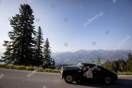 A Lancia Aurelia B 20 GT Da Corsa competes during the Stoderzinken mountain stage of the Ennstal Classic 2018 classic car rally near Groebming, Austria, 20 July 2018. The three days classic car rally Ennstal Classic includes 450 km stages each day through the Austrian mountain landscape on asphaltic roads only. Since 1993 classic cars older than 1972 models can start in the Ennstal Classic rally with an entry fee of 2.500 Euros. Participants from 17 nations, including among others China, Australia, Mexico, Ireland and Japan, compete in the various special stages with prespecified speed averages, which are monitored by secret checkpoints. The drivers and co-drivers are allowed to use mechanical time- and distance measuring devices to check the difference from the target time to prevent penalty points. Some drivers point out that the socializing factor is much more important than the sports and completion ambitions. In 2018 the oldest classic car of the 238 competitors is a Bugatti 37A (70 horse power, 1496 ccm) from 1928. Classic cars of 51 car brands, among others Alvis, Auburn, Devin, Iso Rivolta, Riley, Lagonda, Siata, DKW, Ballot, AC Cobra and Talbot take part in the rally. German sports car manufacturer Porsche comes up with 43 cars, Jaguar with 30 vehicles, Italian Alfa Romeo with 22 and Mercedes Benz with 19 vintage cars.