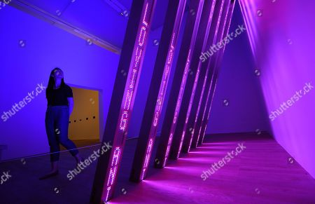 A Tate Modern staff looks over an installation by US artist Jenny Holzer during the 'Artist Rooms' exhibit at the Tate Modern in London, Britain, 20 July 2018. Artist Rooms is a touring collection of over 1,600 works of modern and contemporary art. Holzer's work will be on show from 23 July 2018 to 31 July 2019.