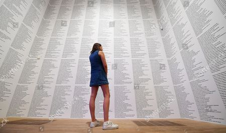 A Tate Modern staff looks over an text based artwork by US artist Jenny Holzer during the 'Artist Rooms' exhibit at the Tate Modern in London, Britain, 20 July 2018. Artist Rooms is a touring collection of over 1,600 works of modern and contemporary art. Holzer's work will be on show from 23 July 2018 to 31 July 2019.