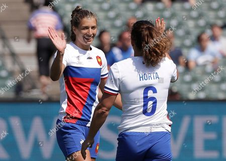 France's Lina Guerin, left, celebrates after scoring against Japan with Fanny Horta (6) during the Women's Rugby Sevens World Cup in San Francisco