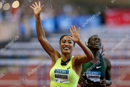 Queen Harrison of the US celebrates after winning the women's 100 m hurdles race during the IAAF Diamond League Athletics meeting at the Louis II Stadium in Monaco