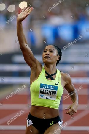 Stock Image of Queen Harrison of the US celebrates after winning the women's 100 m hurdles race during the IAAF Diamond League Athletics meeting at the Louis II Stadium in Monaco