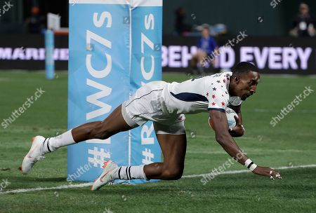 United States's Perry Baker scores against Wales during the Rugby Sevens World Cup in San Francisco