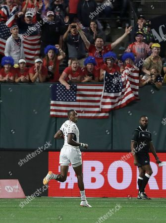 Fans cheer as the United States's Perry Baker scores against Wales during the Rugby Sevens World Cup in San Francisco