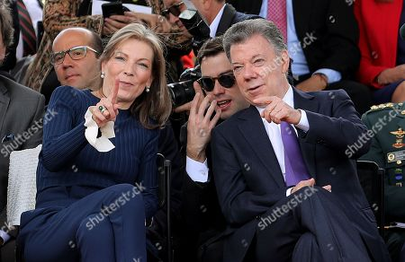 The President of Colombia Juan Manuel Santos (R), his wife Maria Clemencia Rodriguez (L), and his son Esteban Santos (C), speak attend the military parade on the occasion of the Independence of Colombia, in Bogota, Colombia, 20 July 2018.
