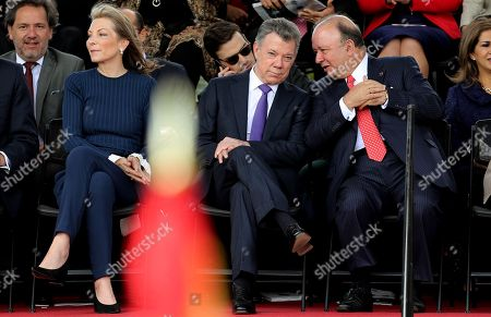Stock Photo of The President of Colombia Juan Manuel Santos (C), accompanied by his wife Maria Clemencia Rodriguez (L), speaks with the Minister of Defense Luis Carlos Villegas (R) during the military parade on the occasion of the Independence of Colombia, in Bogota, Colombia, 20 July 2018.