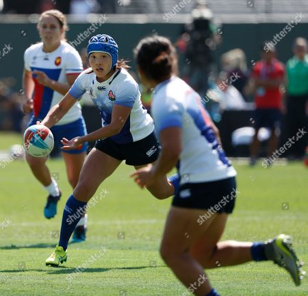 Emii Tanaka (R) of Japan passes the ball to teammate Yume Okuroda (L) in action against France during the Rugby World Cup Sevens Round of Sixteen match between Japan and France in San Francisco, California USA, 20 July 2018.