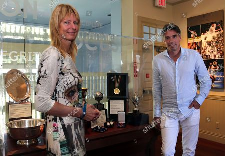 Helena Sukova, Michael Stich. Tennis Hall of Fame inductees Helena Sukova, of Czech Republic, and Michael Stich, of Germany, pose with their trophies in the International Hall of Fame Museum, in Newport, R.I