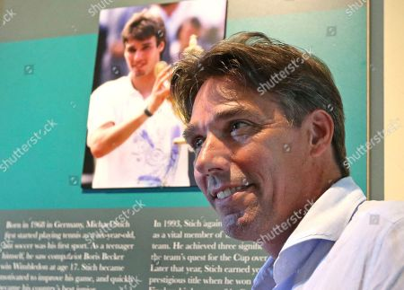 Tennis Hall of Fame inductee Michael Stich, of Germany, poses inside the International Tennis Hall of Fame Museum, in Newport, R.I
