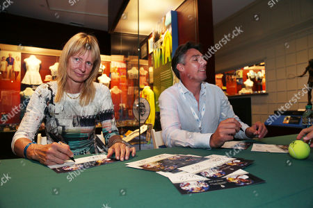 Tennis Hall of Fame inductees Helena Sukova, of Czech Republic, and Michael Stich, of Germany, sign autographs in the International Tennis Hall of Fame Museum, in Newport, R.I