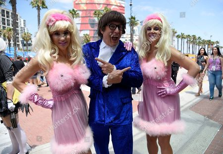 Stock Photo of Gayle Sherman, Mark Sherman, Samantha Sherman. Mark Sherman, center, dressed as Austin Powers, Gayle Sherman, left, and Samantha Sherman, right, dressed as Fembots, attend day two of Comic-Con International, in San Diego
