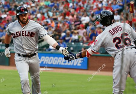Jason Kipnis, Rajai Davis. Cleveland Indians' Jason Kipnis, left, celebrates his two-run home run with Rajai Davis (26) against the Texas Rangers during the second inning of a baseball game, in Arlington, Texas