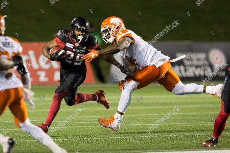 Ottawa Redblacks William Powell (29) runs with the ball while BC Lions Odell Willis (11) defends during the CFL game between the BC Lions and Ottawa Redblacks at TD Place Stadium in Ottawa, Canada. Ottawa won by a score of 29-25