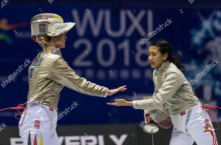 Ann Sophie Kindler (L) of Germany greets with Ywen Lau (R) from Singapore after their match in the women's Sabre first round at the Fencing World Championships in Wuxi, China, 21 July 2018.