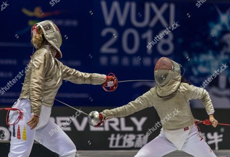 Stock Image of Ann Sophie Kindler (L) of Germany competes against Ywen Lau (R) from Singapore in the women's Sabre first round at the Fencing World Championships in Wuxi, China, 21 July 2018.