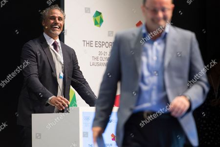 Canadian-Bahamian film and television actor, businessman, retired basketball player, and esports franchise owner Rick Fox, (L), and Swiss Patrick Baumann, (R), president of the Global Association of International Sports Federations (GAISF) open the first edition of the International Olympic Committee (IOC) Esports Forum at the Olympic Museum, in Lausanne, Switzerland, 21 July 2018.