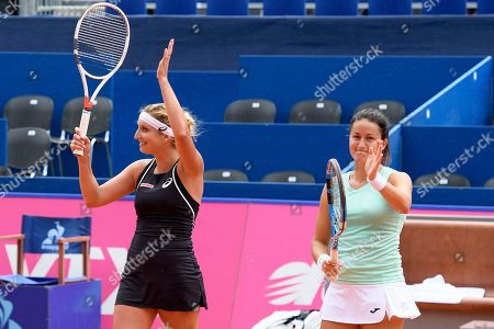 Lara Arruabarrena of Spain, right, and Timea Bacsinszky of Switzerland, left, celebrate after winning their doubles match against Alexandra Panova of Russia and Galina Voskoboeva of Kazakhstan (not pictured) during the semi-finals game at the WTA Ladies Championship tennis tournament in Gstaad, Switzerland, this Saturday, July 21, 2018.