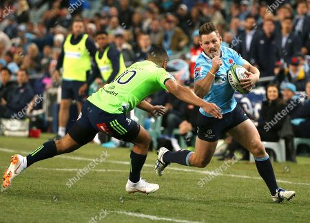 Bernard Foley, Lima Sopoaga. Waratahs' Bernard Foley, right, attempts to run past Highlanders' Lima Sopoaga during their Super Rugby quarterfinal match in Sydney
