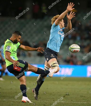Ned Hanigan, Lima Sopoaga. Waratahs' Ned Hanigan, right, attempts to block a kick from Highlanders' Lima Sopoaga during their Super Rugby quarterfinal match in Sydney