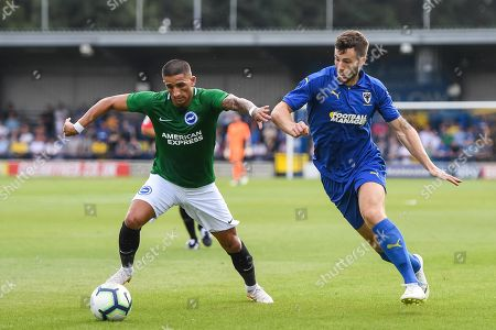 Stock Image of AFC Wimbledon Defender Jonathan Meades (3) and Brighton & Hove Albion Midfielder Anthony Knockaert (11) battle for the ball during the Pre-Season Friendly match between AFC Wimbledon and Brighton and Hove Albion at the Cherry Red Records Stadium, Kingston. Picture by Stephen Wright