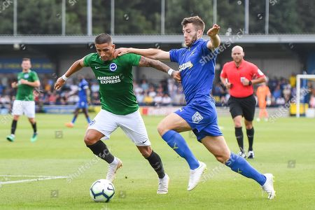 AFC Wimbledon Defender Jonathan Meades (3) and Brighton & Hove Albion Midfielder Anthony Knockaert (11) battle for the ball during the Pre-Season Friendly match between AFC Wimbledon and Brighton and Hove Albion at the Cherry Red Records Stadium, Kingston. Picture by Stephen Wright
