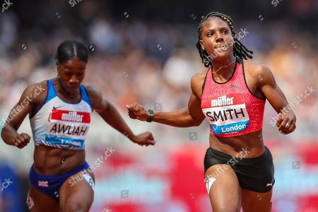 Stock Image of Kristal AWUAH of Great Britain and Jonielle SMITH of Jamaica in Heat 2 of the Women's 100m during the 2018 Müller Anniversary Games at the London Stadium, London. Picture by Toyin Oshodi