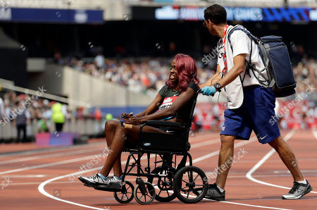 Ashley Spencer of the U.S. leaves the track on a wheelchair after getting injured and finishing last in the women's 400 meters hurdles race at the IAAF Diamond League athletics meeting at London Stadium in London