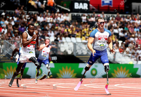 Stock Photo of Richard Whitehead of Great Britain and Ntando Mahlangu of South Africa during the Mens T61 200m.