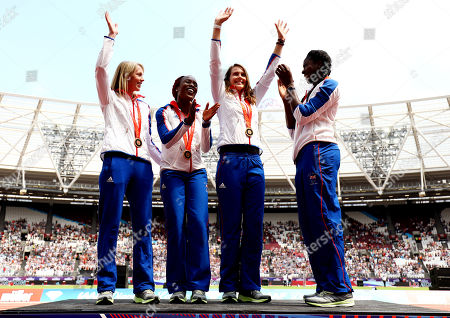 The Great Britain Womens 4x400m team of Nicola Sanders, Marilyn Okoro, Kelly Sotherton and Christine Ohuruogu celebrate receiving a bronze medal from the 2008 Beijing Olympics after disqualification of the previous bronze medalists.