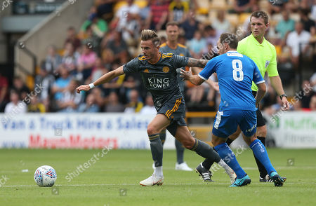 Leicester City's James Maddison battles with Notts County's David Vaughan