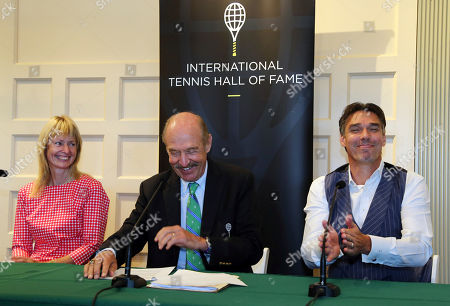 Michael Stich, Helena Sukova, Stan Smith. Tennis Hall of Fame inductees Helena Sukova, of Czech Republic, and Michael Stich, of Germany, react as they are introduced by Stan Smith, middle, at a news conference at the International Tennis Hall of Fame, in Newport, R.I