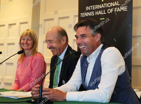 Michael Stich, Helena Sukova, Stan Smith. Tennis Hall of Fame inductees Helena Sukova, of Czech Republic, and Michael Stich, of Germany, laugh with Stan Smith, middle, during a news conference at the International Tennis Hall of Fame, in Newport, R.I