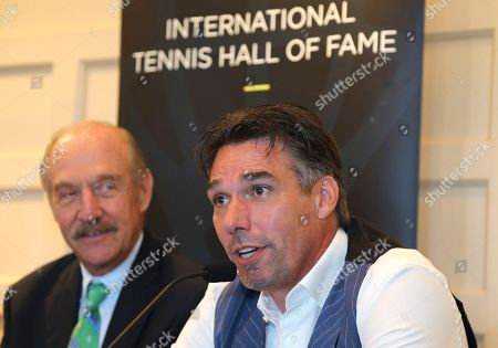 Michael Stich, Stan Smith. Tennis Hall of Fame inductee Michael Stich, of Germany, right, speaks as Hall of Fame President Stan Smith listens during a news conference at the International Tennis Hall of Fame, in Newport, R.I