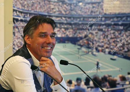 Tennis Hall of Fame inductee Michael Stich, of Germany, smiles during a news conference at the International Tennis Hall of Fame, in Newport, R.I