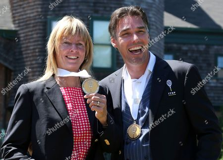 Michael Stich, Helena Sukova. Tennis Hall of Fame inductees, Helena Sukova, of Czech Republic, and Michael Stich, of Germany, pose with their medals during ceremonies at the International Tennis Hall of Fame, in Newport, R.I
