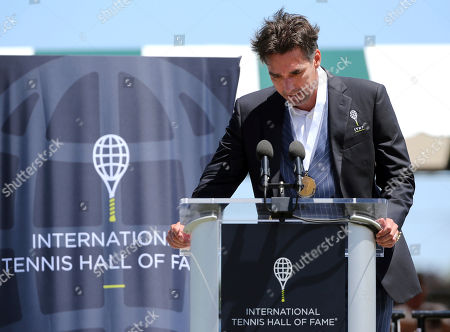 Tennis Hall of Fame inductee, Michael Stich, of Germany, becomes emotional as he speaks during ceremonies at the International Tennis Hall of Fame, in Newport, R.I