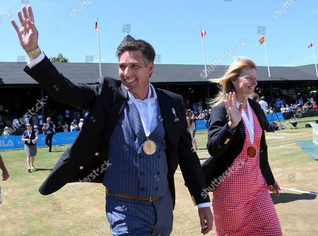 Tennis Hall of Fame inductees, Michael Stich, of Germany, and Helena Sukova, of Czech Republic, wave to fans during ceremonies at the International Tennis Hall of Fame, in Newport, R.I