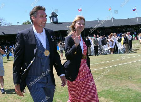 Stock Picture of Tennis Hall of Fame inductees, Michael Stich, of Germany, and Helena Sukova, of Czech Republic, wave to fans during ceremonies at the International Tennis Hall of Fame, in Newport, R.I