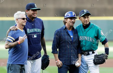 Eddie Vedder, third from left, and Mike McCready, left, both of the rock band Pearl Jam, pose for a photo, with Seattle Mariners pitcher Felix Hernandez, second from left, and Ichiro Suzuki, right, special assistant to the chairman, after Vedder and McCready threw out the first pitches of a baseball game between the Mariners and the Chicago White Sox at Safeco Field in Seattle. Pearl Jam is scheduled to play two concerts in August at the ballpark