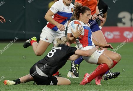 France's Fanny Horta, right, is tackled by New Zealand's Kelly Brazier (8) during the Women's Rugby Sevens World Cup final in San Francisco, . New Zealand won 29-0