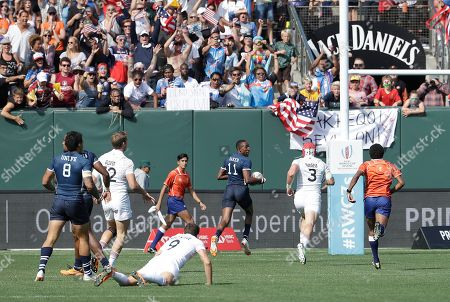 United States's Perry Baker (11) scores against England during the Rugby Sevens World Cup in San Francisco