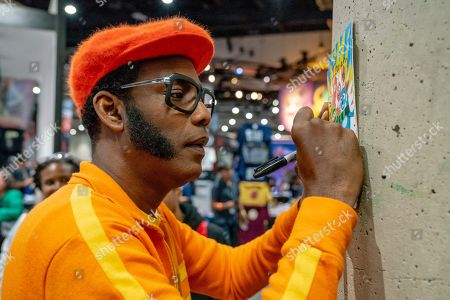 "DJ Lance Rock"", Lance Robertson, of ""Yo Gabba Gabba"", signs autographs for fans on day two of Comic-Con International on in San Diego, CA"